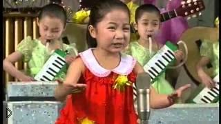 Смотреть онлайн Большой детский хор поет в Корее