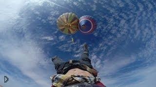 Смотреть онлайн Канатоходцы экстремалы между двух воздушных шаров