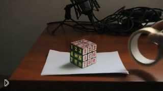 Смотреть онлайн Оптическая иллюзия с кубиком Рубика