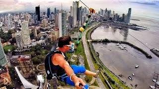 Смотреть онлайн Опасные прыжки с парашютом с городского здания