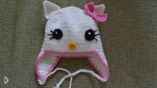 Смотреть онлайн Схема вязания детской шапочки с ушками крючком