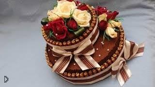 Смотреть онлайн Сладкий подарок своими руками: торт из конфет