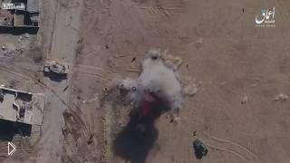 Смотреть онлайн В Сирии беспилотник кидает бомбу на автомобиль